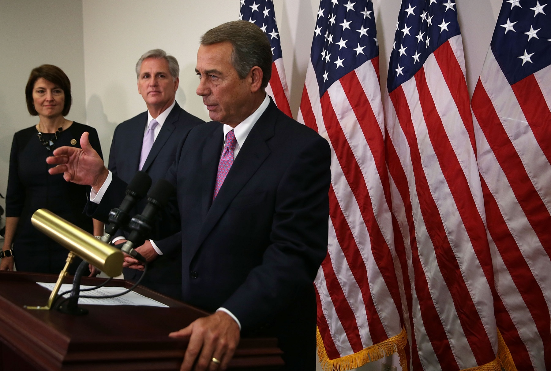 U.S. Speaker of the House Rep. John Boehner (R-OH) (R) speaks as House Majority Leader Rep. Kevin McCarthy (R-CA) (2nd L) and Rep. Cathy McMorris Rodgers (R-WA) (L) listen during a news briefing after a House Republican Caucus meeting October 27, 2015 at the Capitol in Washington, DC.