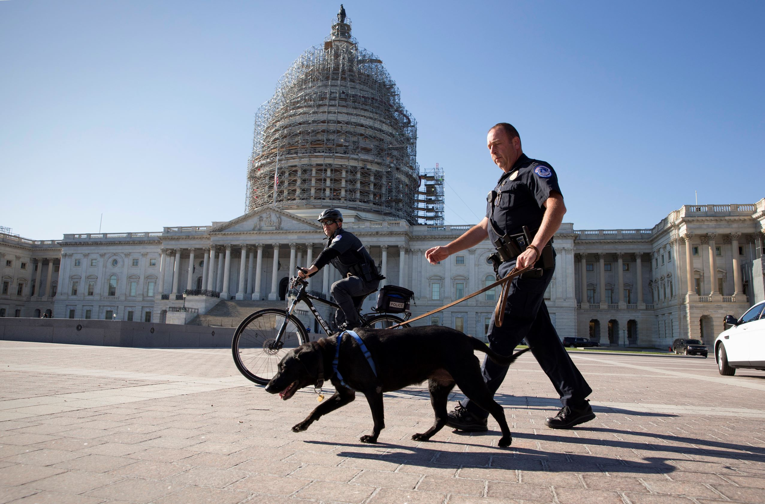 U.S. Capitol Police officers keep watch over the East Front of the Capitol as Congress prepares to return to work following the weekend terror attacks in Paris that killed 129 people, in Washington, Monday, Nov. 16, 2015.