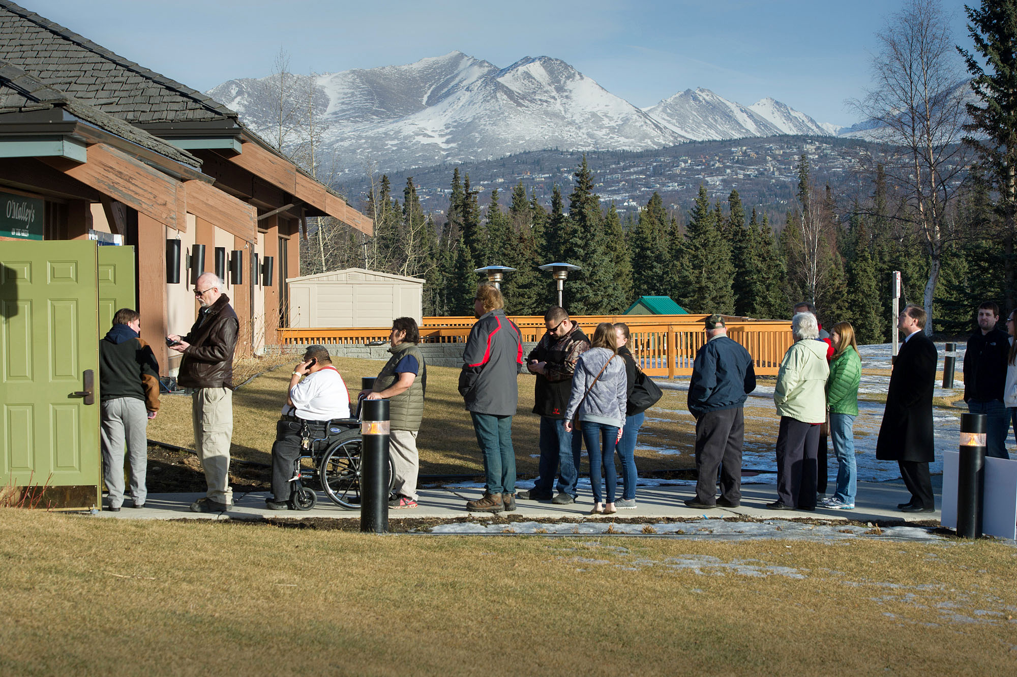Republican voters line up outside a polling place Tuesday, March 1, 2016 in Anchorage, Alaska. Alaska Republicans are poised to decide which of the remaining GOP presidential candidates will get their support.