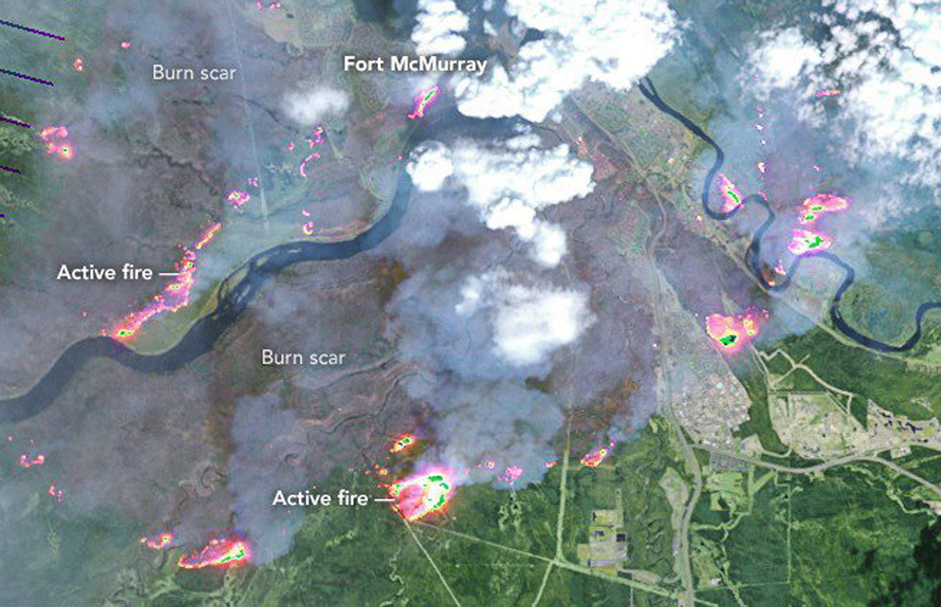 On May 4, 2016, the the Enhanced Thematic Mapper Plus (ETM+) on the Landsat 7 satellite acquired this false-color image of the wildfire that burned through Fort McMurray in Alberta, Canada. The image combines shortwave infrared, near infrared, and green light (bands 5-4-2). Near- and short-wave infrared help penetrate clouds and smoke to reveal the hot spots associated with active fires, which appear red. Smoke appears white and burned areas appear brown.