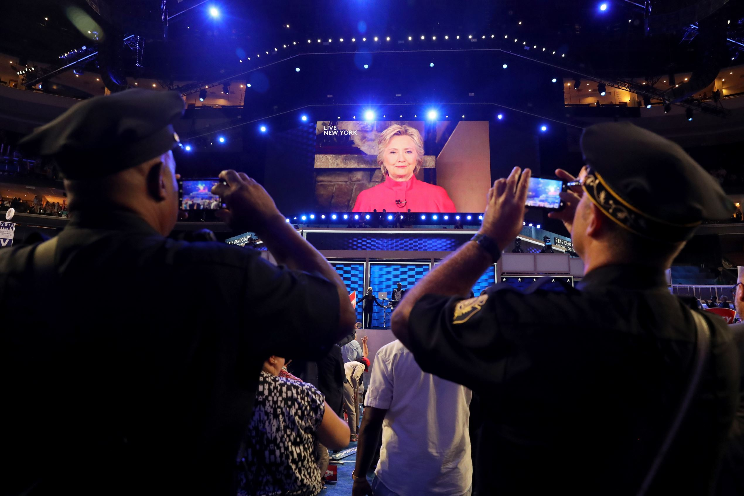 A screen displays Democratic presidential candidate Hillary Clinton delivering remarks to the crowd during the evening session on the second day of the Democratic National Convention at the Wells Fargo Center, July 26, 2016 in Philadelphia, Pennsylvania.