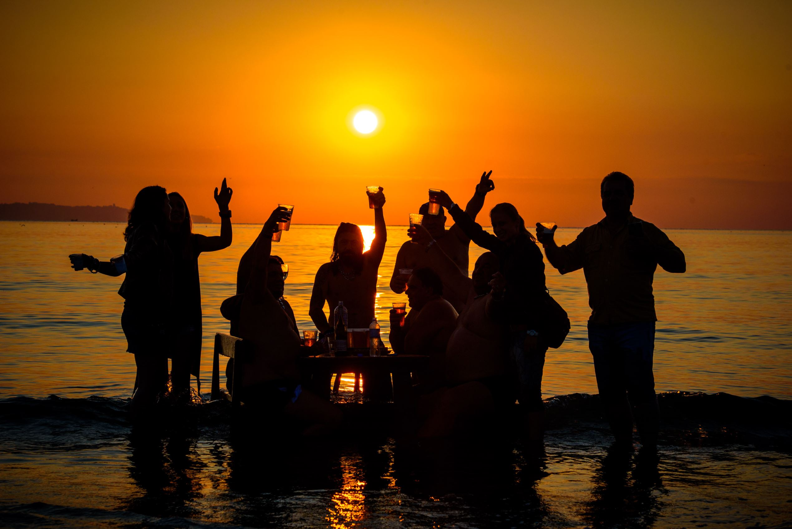 Слайд 63 из 86: Bulgarians celebrate July Morning in Varna, Bulgaria - 01 Jul 2016 Bulgarians greet the sunrise as they swim, play and kiss on the shore of the Black Sea town of Varna