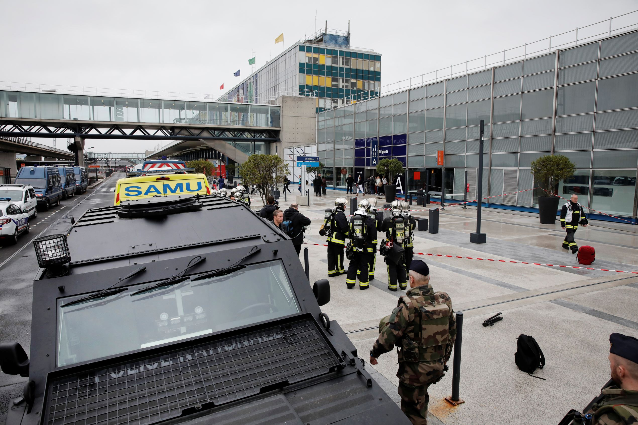Slide 1 of 14: Military and emergency services outside Orly airport southern terminal after a shooting incident near Paris, France March 18, 2017.