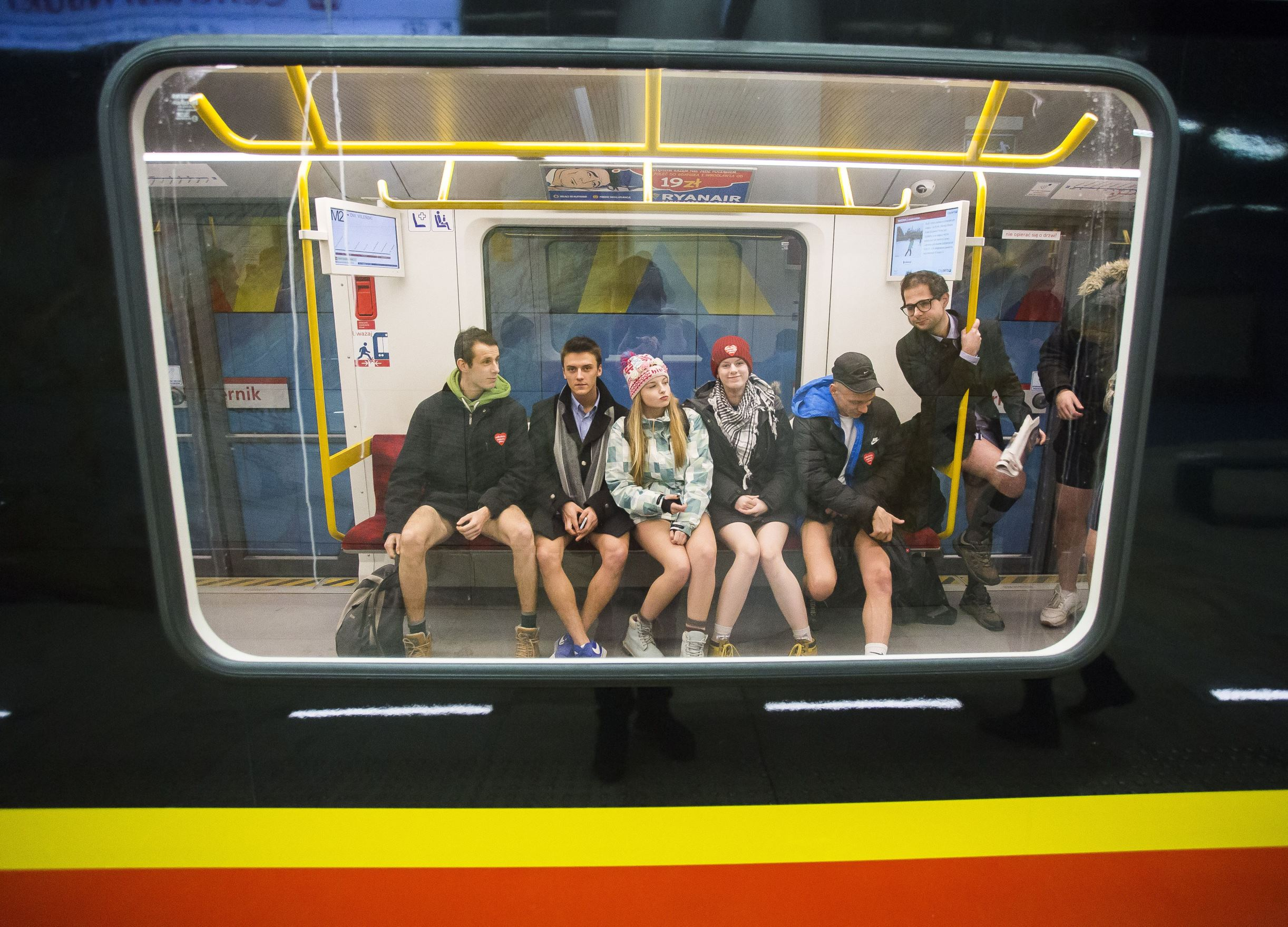 No Pants Subway Ride, Warsaw, Poland - 10 Jan 2016 People without pants sit in a subway car while happening to celebrate the day's ride the subway without pants in Warsaw