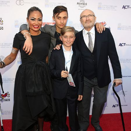 Phil with his third wife and their children