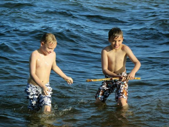 Landon and Gage Jones play in Lake Superior.