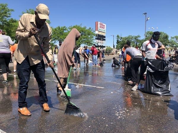 Volunteers clean up streets.