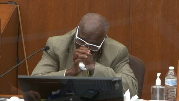A man cries on the witness stand.