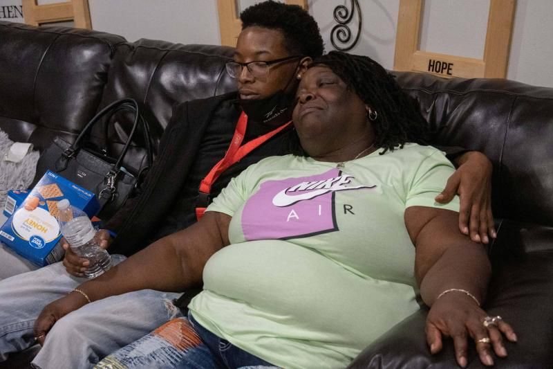 Jackie resting on the couch next to her grandson Willie.