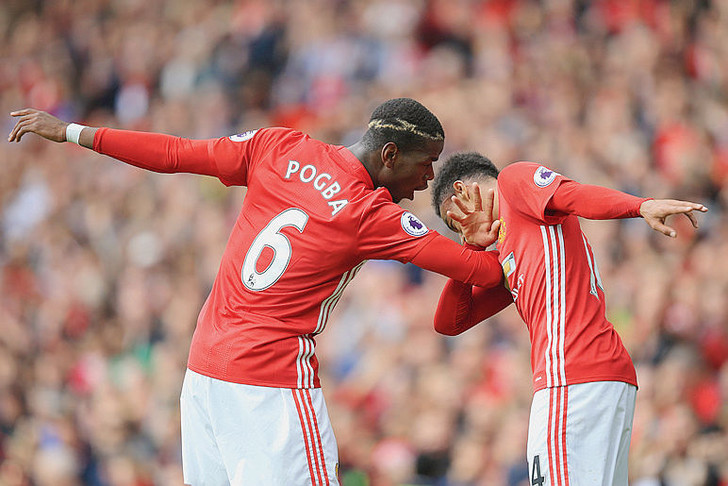 24 September 2016 - Premier League - Manchester United v Leicester City - Paul Pogba and Jesse Lingard of Manchester United celebrate with a trademark 'dab' - Photo: Marc Atkins / Offside.