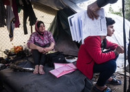 Iraqi refugees with asylum request documents at camp Samos