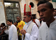 The archbishop of Havana, Monsignor Juan Garcia, leads the procession of the Virgin ...