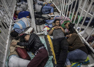 Venezuelan migrants sleep while waiting for the opening of a job fair.