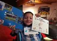Mohamed Amine with the diploma of the small athlete autographed by the old football player