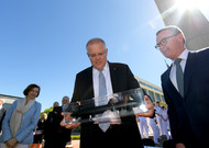 Australian ministers Christopher Pyne and Scott Morrison with a model of ...