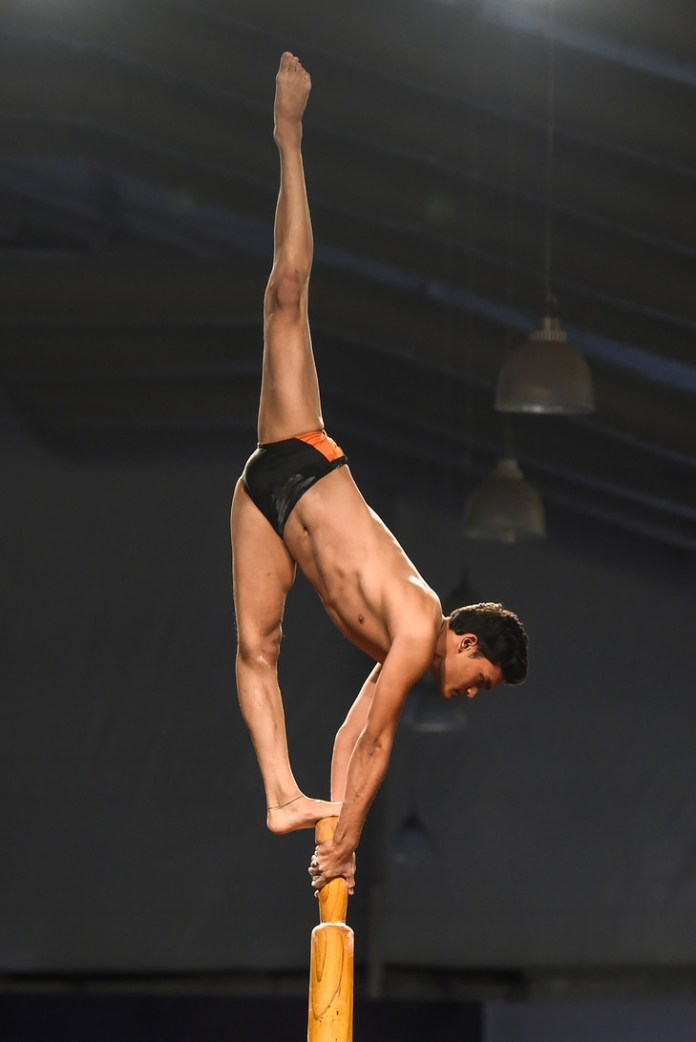 A gymnast performs a figure at the Mallakham World Championships, a former Indian sports discipline, on February 16, 2019 in Mumbai, India / AFP