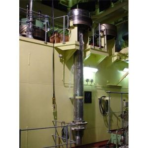 What is the construction of a marine diesel engine piston used on board ships?