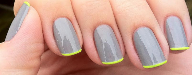 A pop of neon brightens monochromatic nails.