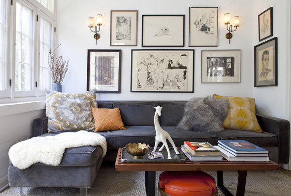 In small living rooms, one large couch instead of multiple small pieces actually decreases the look of clutter and makes a room feel bigger.