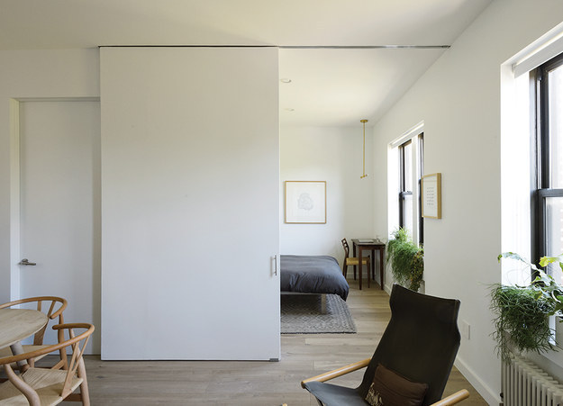 This Brooklyn apartment feels much larger than its 500 square feet, thanks to large sliding doors with wide doorways.