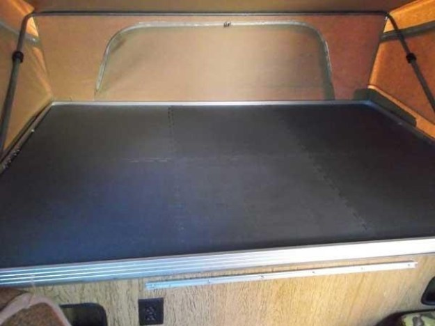 Anti-fatigue floor mats on the bottoms of bunks add comfort and insulation.