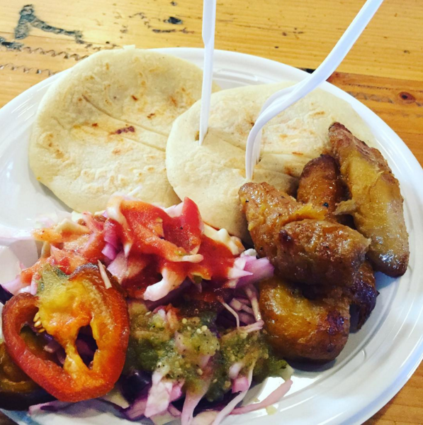 What about these delightful Salvadoran pupusas filled with gooey cheese, refried beans, and perfectly seasoned pork, with a side of platanos and curtido?