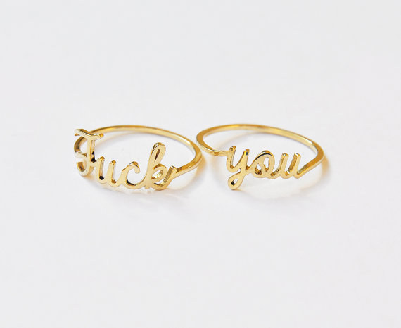 Elegant rings that show exactly how classy swearing can be.