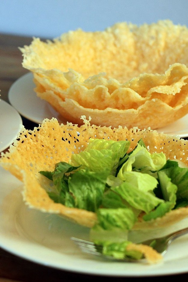 Press and microwave grated Parmesan cheese into a dish shape.