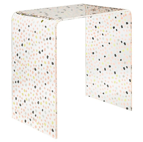 A dotty accent table with maximal storage space underneath.