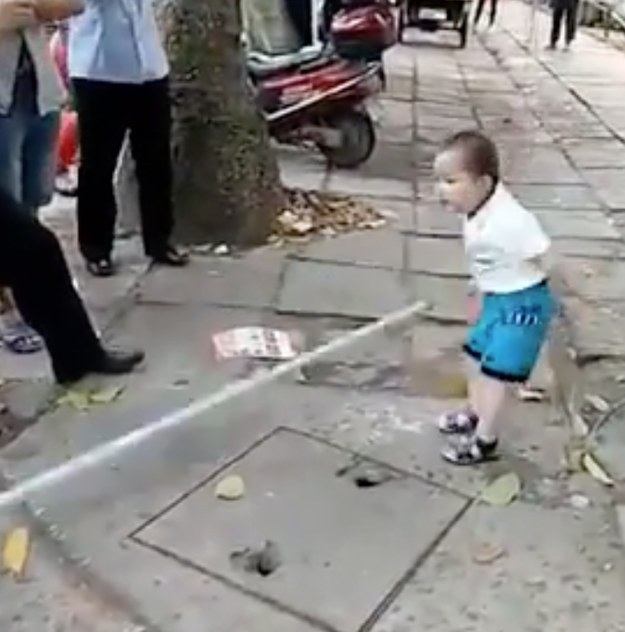 """The boy tenaciously screams, """"Don't touch my grandma! Go away, don't touch my grandma!"""" as onlookers film and chuckle at his aggression."""