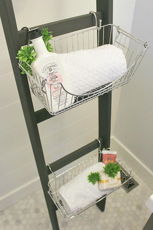 Or use a slim wooden ladder, s-hooks, and baskets to squeeze storage out of an awkward corner.