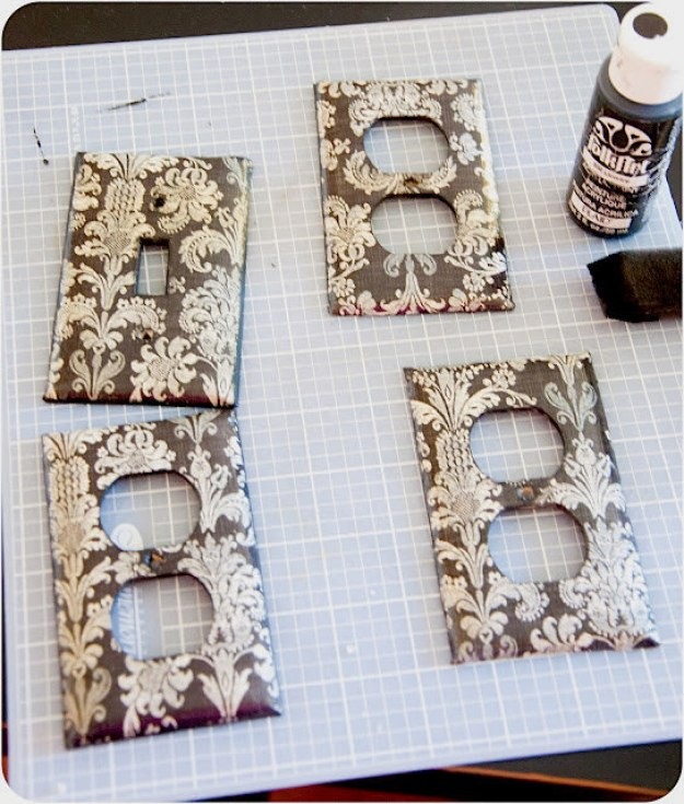 Mod Podge scrapbook paper onto your outlet and switch covers.