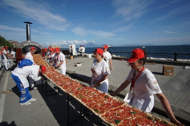 Standing along the city's waterfront, the pizza makers managed to bake a 1,853.88 meter wood-oven pizza, which translates to about 6,082 feet, Guinness World Records spokesperson Sofia Rocher said.