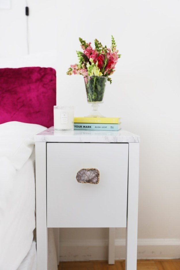 Fancy up your nightstand with marble contact paper and a new drawer pull.