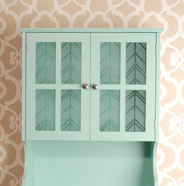 Etch a herringbone pattern into glass in your cabinets with translucent glass paint.