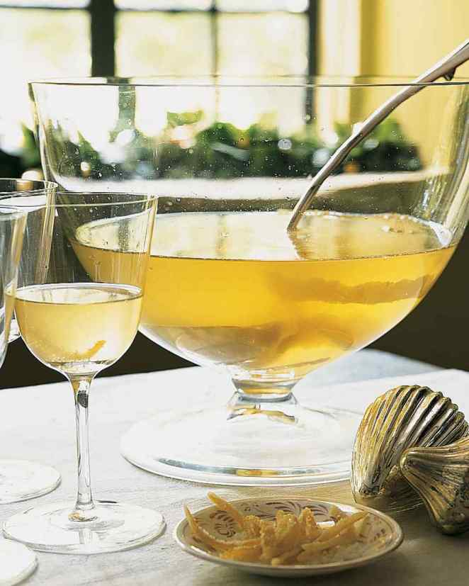A tart and bubbly lemonade drink perfect for slow sipping on your stoop. Here's the recipe for lemon drop Champagne punch.