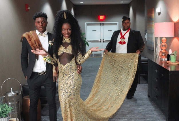 These teens took prom to a whole new level. This is Autumn from Michigan in her Coming to America-inspired prom dress. Here she is accompanied by Prince Akeem and Oha.