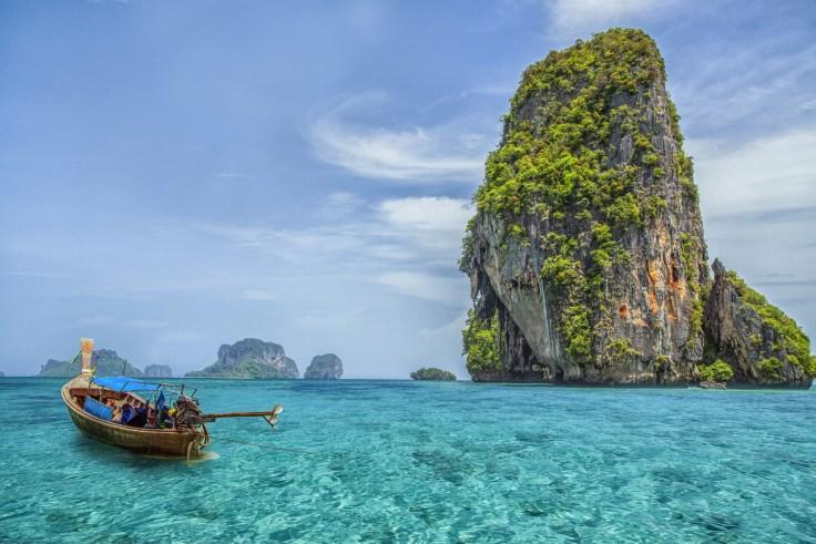 Take a boat tour around the island of Phuket, Thailand.