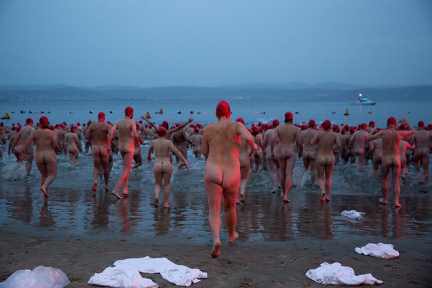 It was nine degrees on a winter morning in Hobart, and all these people could think about was stripping down and running bare naked into the Derwent River.