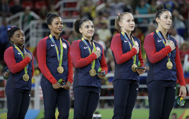 But some people are attacking Douglas online for having her hands by her sides instead of placing one hand on her heart during the national anthem at the medal ceremony.