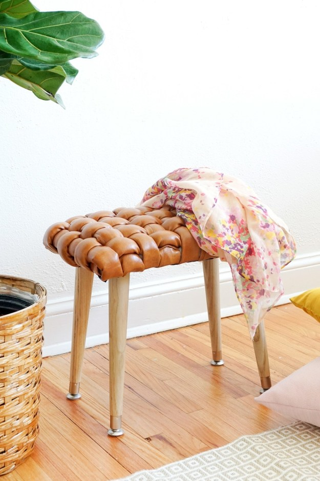 Impress everyone with a woven leather stool.