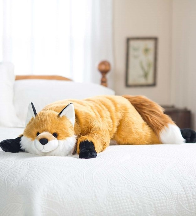 A body pillow shaped like an enormous fox.