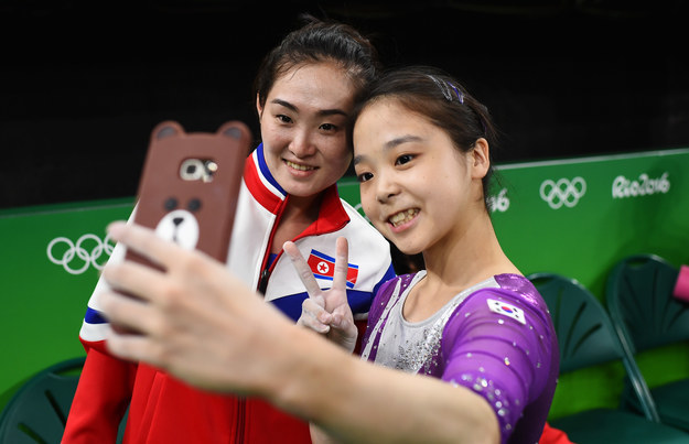 Two gymnasts are showing the healing power of sports by posing for a selfie during the 2016 Rio Olympics.