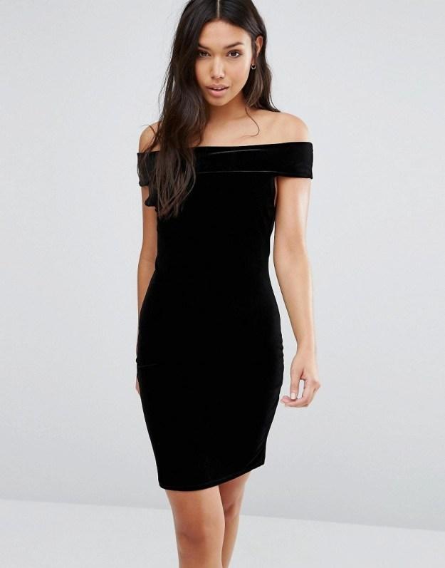 A black velvet dress that goes off the shoulders.