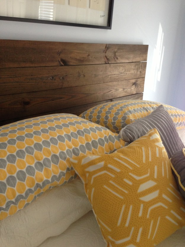 Connect several 1x6 boards together to make a custom headboard for about $60.
