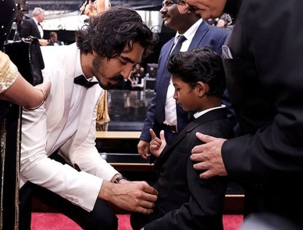 And the two of them together – whoa boy, it's too much for anybody to handle. Here's Dev adjusting his little buddy's tie so that he looks his adorable best for the cameras.