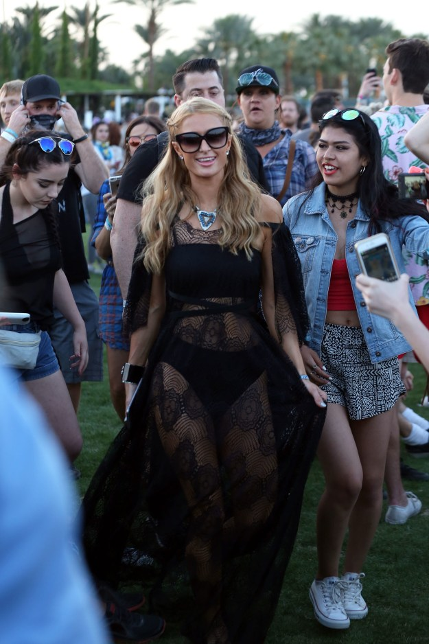 I am going to be blunt here because I have opinions and I hate lies (but love drama): Vanessa Hudgens is a problematic troll and Paris Hilton is the one true, actual queen of Coachella.