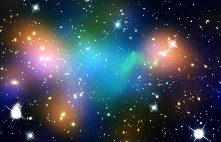 "This composite image shows the distribution of dark matter, galaxies, and hot gas in the core of the merging galaxy cluster Abell 520. The natural-color image of the galaxies was taken with NASA's Hubble Space Telescope and with the Canada-France-Hawaii Telescope in Hawaii. Superimposed on the image are ""false-colored"" maps showing the concentration of starlight, hot gas, and dark matter in the cluster."