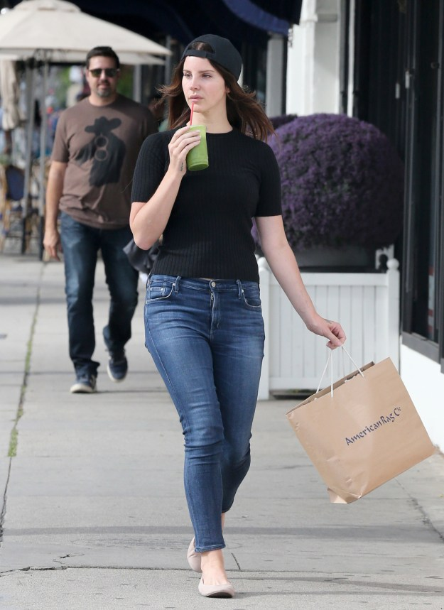Lana Del Rey was spotted shopping in everyday goddess apparel while sipping green juice when suddenly...