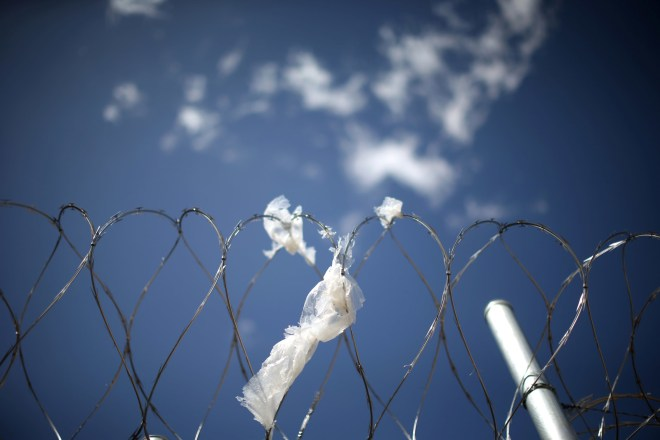 A razor wire fence surrounds the Adelanto immigration detention center, which is run by the Geo Group Inc.